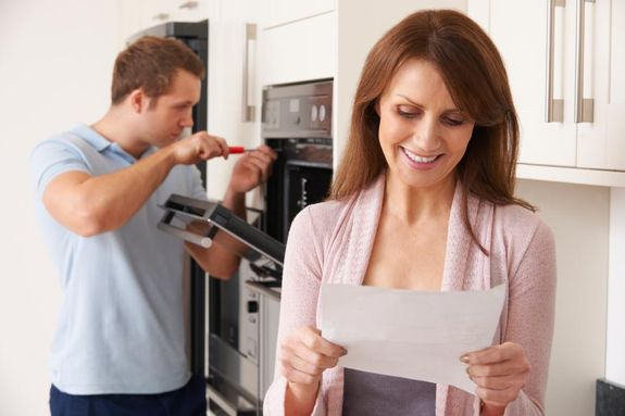Woman checking her appliance repair bill